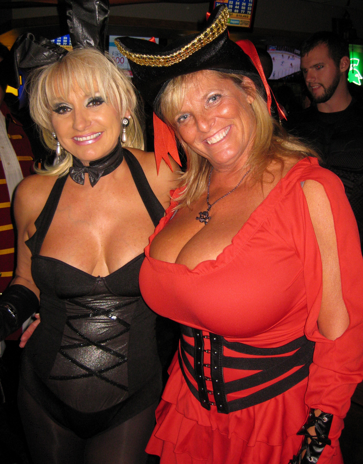 Mature woman with giant big tits at Carnival party
